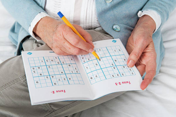 Wall Art - Photograph - Older Woman Doing Sudoku by Lea Paterson/science Photo Library