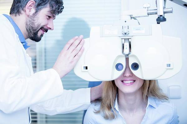 Apply Photograph - Optometrist Performing Eye Test by Science Photo Library