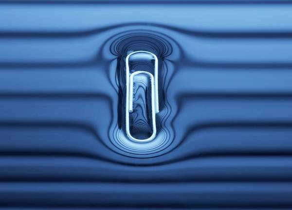 Wall Art - Photograph - Paperclip Floating On Water Surface by Science Photo Library