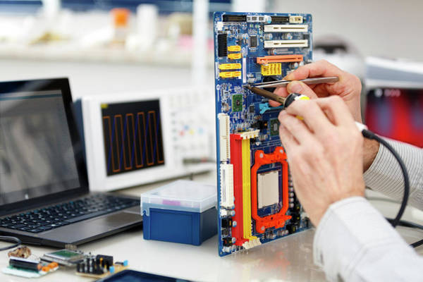 Technological Photograph - Person Repairing Electronic Circuit Board by Wladimir Bulgar