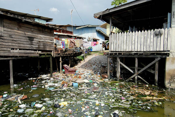 Wall Art - Photograph - Polluted River By Dwellings by Sinclair Stammers/science Photo Library