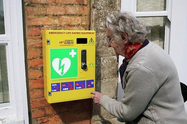 Technological Wall Art - Photograph - Public Defibrillator by Martin Bond