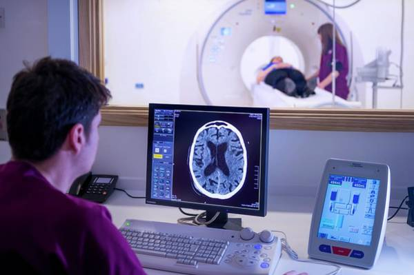 Genesis Photograph - Radiographer Viewing A Ct Scan by Aberration Films Ltd/science Photo Library