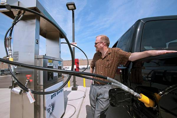 Pickup Man Photograph - Refuelling A Natural Gas Vehicle by Jim West