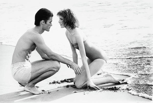 Holiday Photograph - Rene Russo With A Man On A Beach by Francesco Scavullo