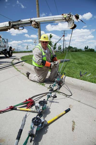 Utility Pole Photograph - Repairing Power Lines by Jim West