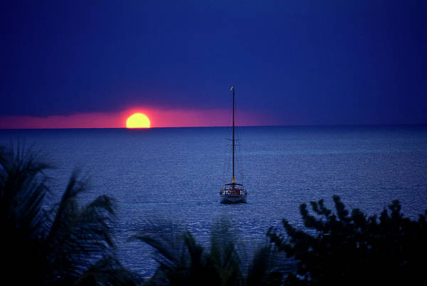Jamaica Photograph - Sailboat At Sunset Under Purple Sky Off by Michael Lawrence