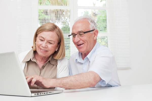 Technological Photograph - Senior Couple Using Laptop by Science Photo Library
