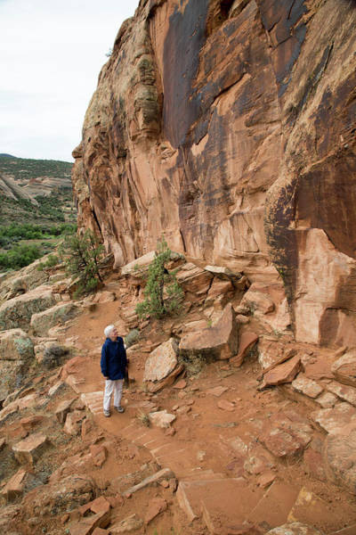 Pictograph Photograph - Senior Woman Hiking by Jim West