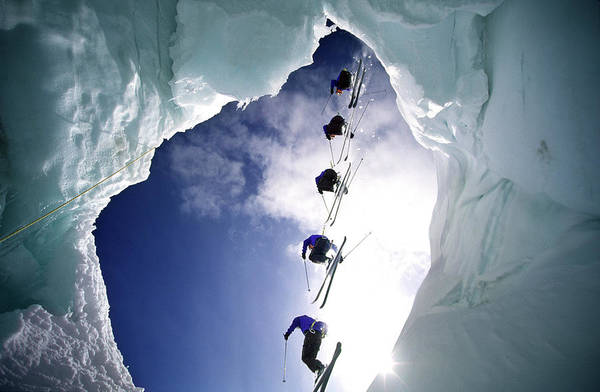 Unusual Perspective Wall Art - Photograph - Skier Is Jumping Over A Glacier Cave by Patrik Lindqvist