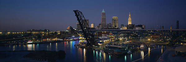 Cleveland Scene Photograph - Skyscrapers Lit Up At Night In A City by Panoramic Images