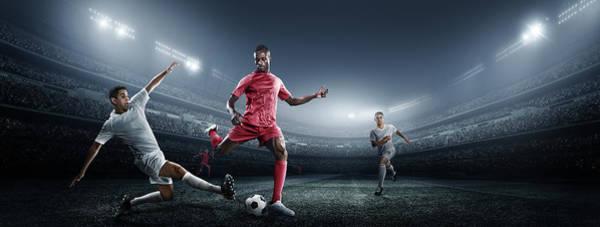 Team Sport Photograph - Soccer Player Kicking Ball In Stadium by Dmytro Aksonov