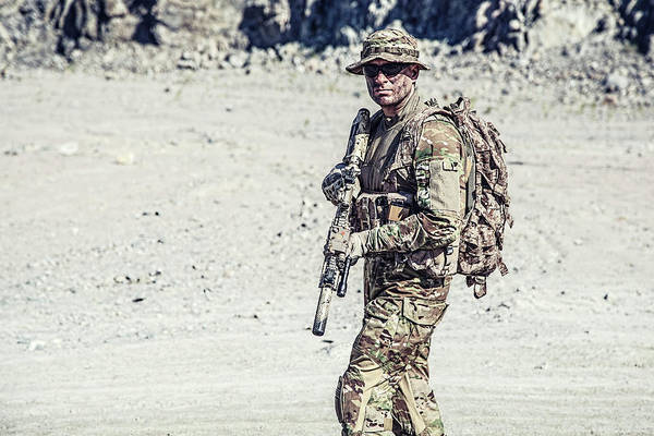 Wall Art - Photograph - Soldier In Field Uniform With Rifle by Oleg Zabielin