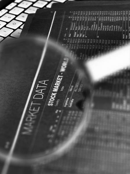 Computer Generated Wall Art - Photograph - Stock Market Figures And Magnifying Glass by Tek Image