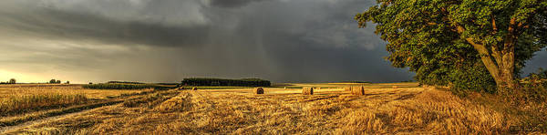 Photograph - Storm Clouds Over Harvested Field In Poland by Julis Simo