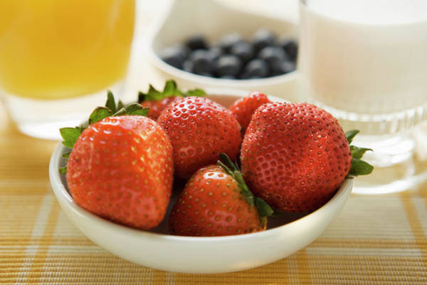 Wall Art - Photograph - Strawberries In A Bowl On Breakfast Table by Foodcollection