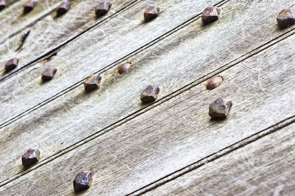 Iron Age Photograph - Studded Wooden Surface by Tom Gowanlock