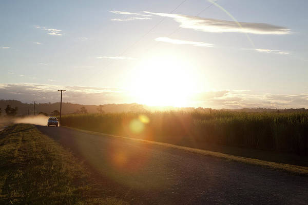 On The Move Photograph - Sun Flare On Australian Country Road by The Photo Commune