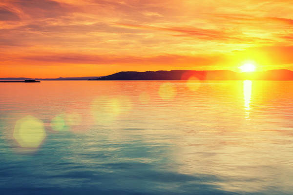 Photograph - Sunset Over Water by Focusstock