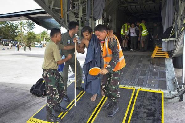 C 130 Photograph - Survivors Of Super Typhoon Haiyan by Jim Edds