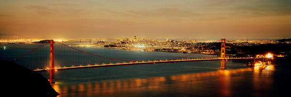Wall Art - Photograph - Suspension Bridge Lit Up At Dusk by Panoramic Images