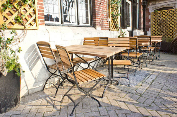 Sidewalk Cafe Photograph - Tables And Chairs by Tom Gowanlock