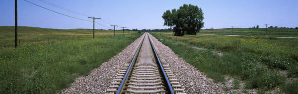 Nebraska Landscape Photograph - Telephone Poles Along A Railroad Track by Panoramic Images