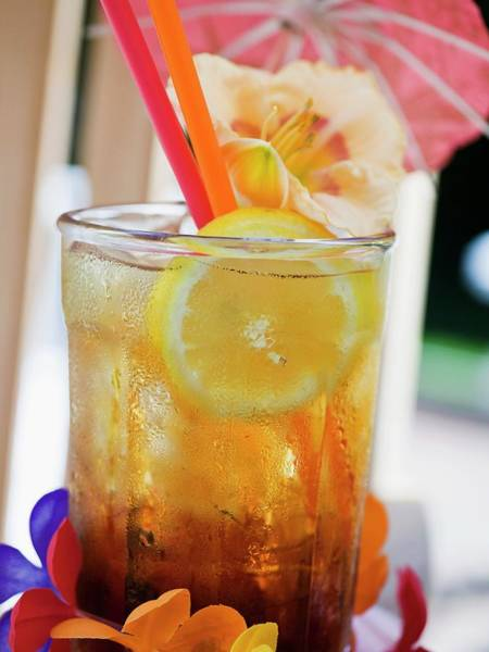 Tequila Sunrise Photograph - Tequila Sunrise With Ice Cubes And Lemon by Foodcollection