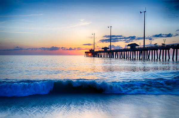 Photograph - The Rising Sun Peeks Through Clouds And Is Reflected In Waves By by Alex Grichenko