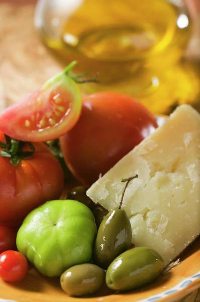 Wall Art - Photograph - Tomatoes, Green Olives And Parmesan On Plate, Olive Oil by Foodcollection