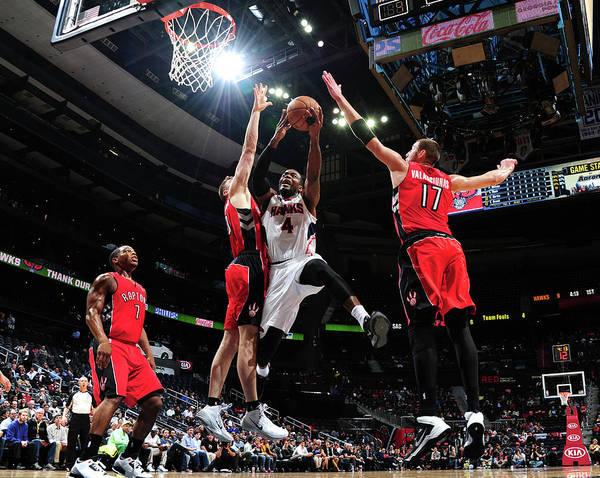 Atlanta Photograph - Toronto Raptors V Atlanta Hawks by Scott Cunningham