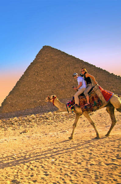 Giza Photograph - Tourists Ride A Camel In Front by Miva Stock
