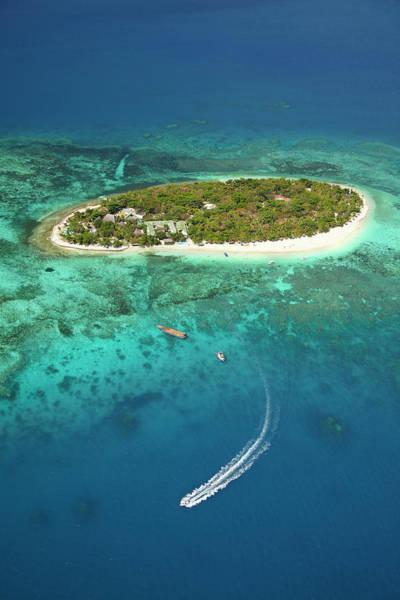 Foreshore Photograph - Treasure Island Resort And Boat by David Wall