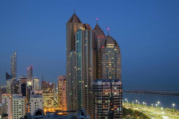Wall Art - Photograph - Uae, Abu Dhabi Elevated Skyline by Walter Bibikow