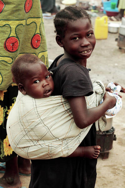 Wall Art - Photograph - Ugandan Girl Carrying A Baby by Mauro Fermariello/science Photo Library