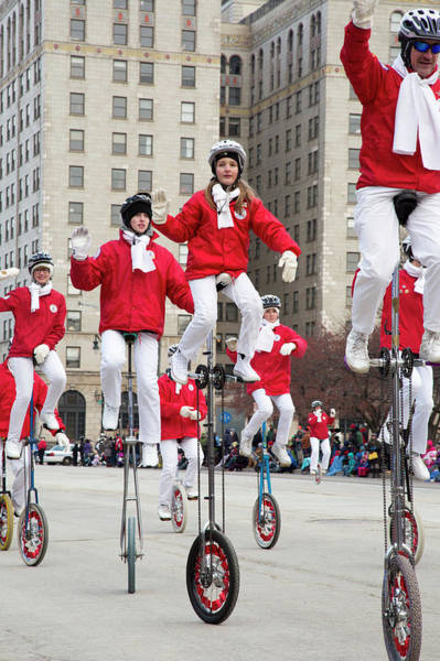Acrobat Photograph - Unicyclists At A Parade by Jim West