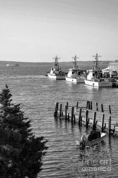 Photograph - Us Coast Guard Cutters In A Harbor At Woods Hole On Cape Cod Massachusetts. by William Kuta
