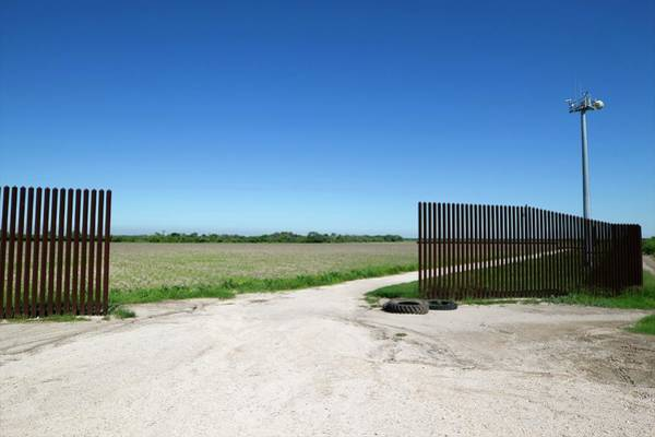 Wall Art - Photograph - Us-mexico Border Fence by Donna Burton - U.s. Customs And Border Protection/science Photo Library