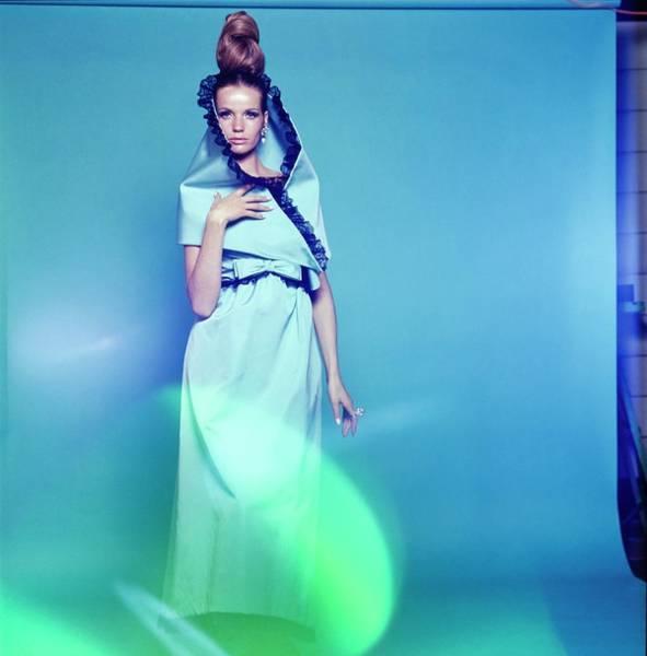 Blue Gown Photograph - Veruschka Wearing Mollie Parnis by Bert Stern