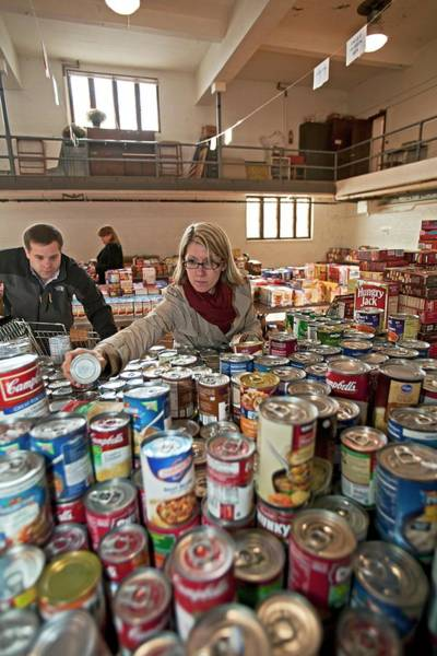 Homeless Photograph - Volunteers At A Food Bank by Jim West