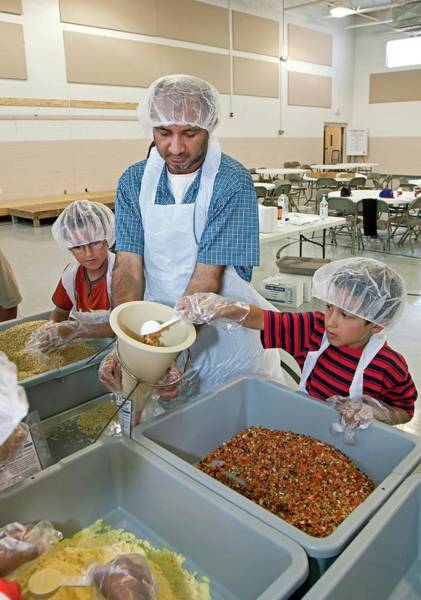 Diversity Wall Art - Photograph - Volunteers Preparing Meal Packages by Jim West