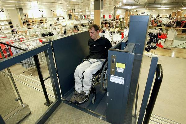 Lift Photograph - Wheelchair User by John Thys/reporters/science Photo Library
