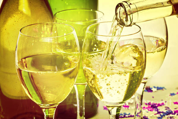 White Wine Wall Art - Photograph - White Wine Pouring Into Glasses by Colin and Linda McKie