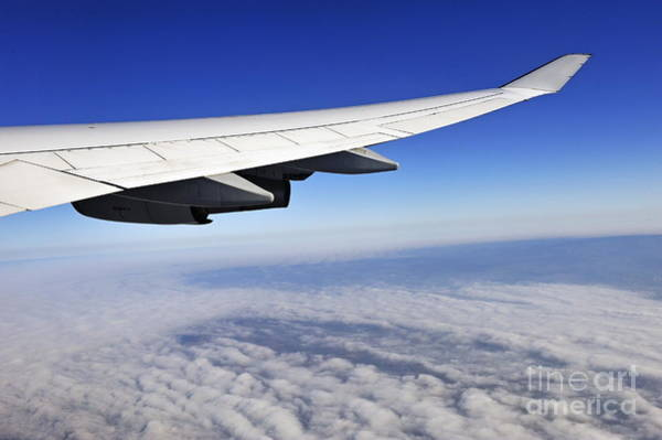 Wall Art - Photograph - Wing Of Flying Airplane Above Clouds by Sami Sarkis