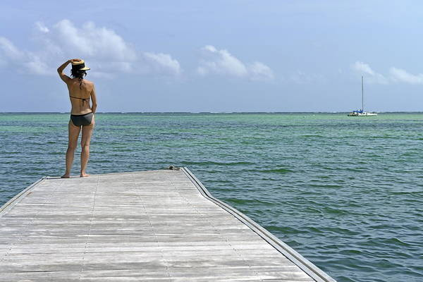 Wall Art - Photograph - Woman Contemplating Ocean From Pontoon by Sami Sarkis