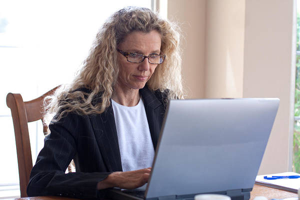 Photograph - Woman On Table With Laptop by Gunter Nezhoda