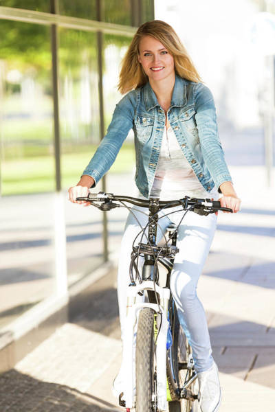 Wall Art - Photograph - Woman Riding A Bicycle by Wladimir Bulgar/science Photo Library