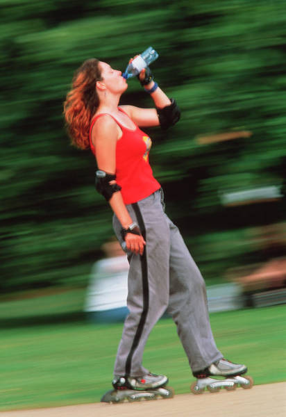 Roller Blades Photograph - Woman Rollerblading by Matthew Munro/science Photo Library