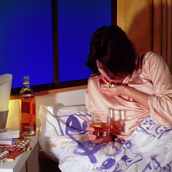 Wall Art - Photograph - Woman Taking A Drug Overdose While Lying In Bed by Cc Studio/science Photo Library