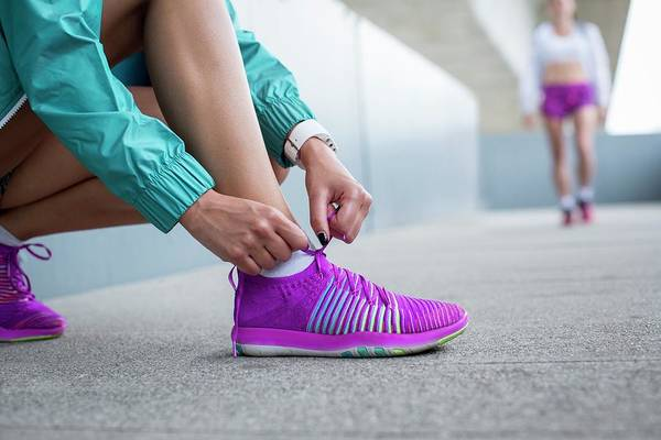 5b362facd212b Shoelace Wall Art - Photograph - Woman Tying Laces On Trainers by Science  Photo Library